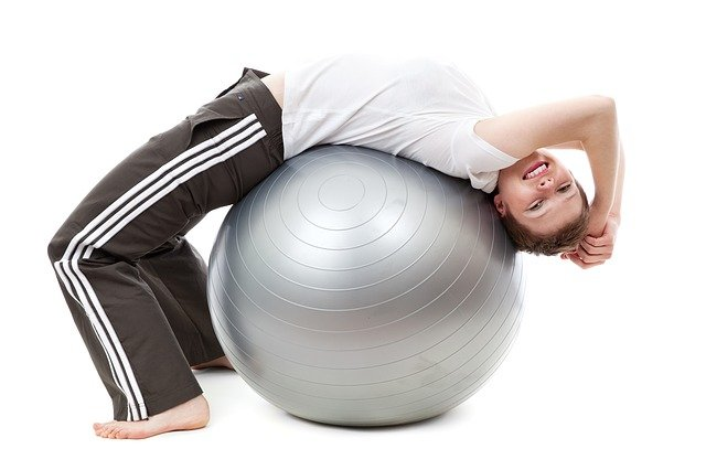 A close up of a person holding a ball